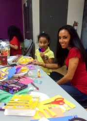 Nicole Desiderio volunteering at the Urban Promise after school program helping the kids with arts and crafts.